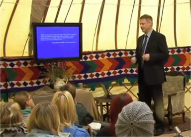 professor in the yurt with  the tv