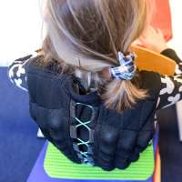 Sand vests in school for kids who cannot but help being kids...